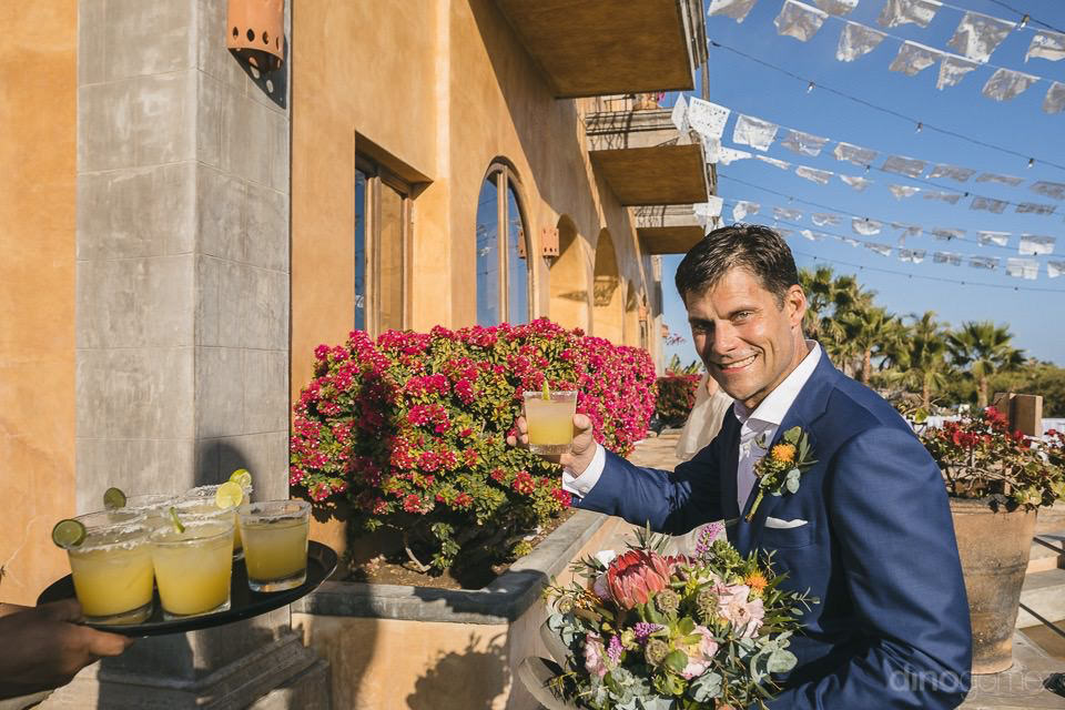 groom holding up a margarita - Rachel & Destin