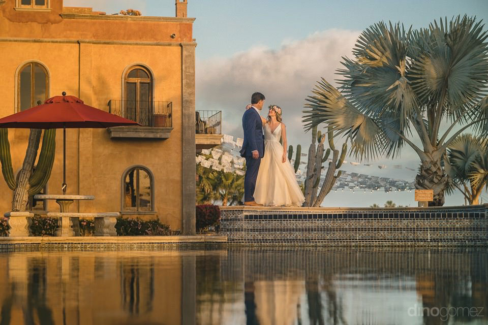 newlyweds reflecting on the water at villa - Rachel & Destin