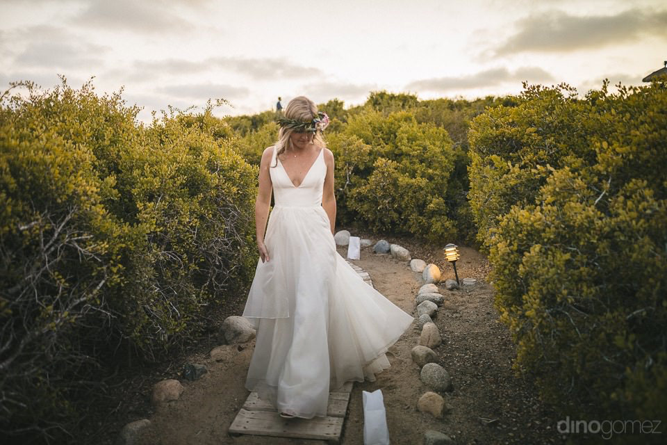 the bride walking surrounded by nature - Rachel & Destin