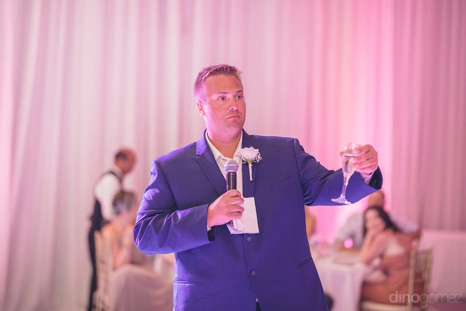 A friend of the lovely couple raising toast to the newly married couple in the presence of all the guests - Shannon & Jordan