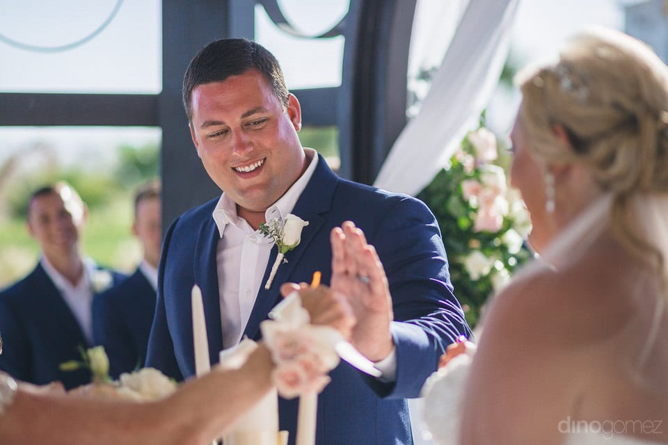 Handsome and happy groom making some getures with hands with another lady present at their wedding - Shannon & Jordan