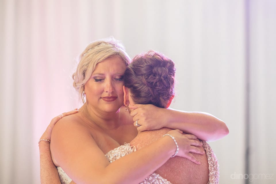 Lovely bride hugging emotionally a lady among the guests at the evening party of the couple - Shannon & Jordan
