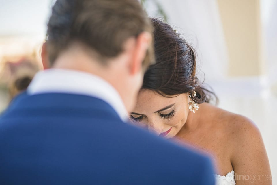 The shy moment between the bride and the groom during their wedding ceremony- Aubrey & Chris