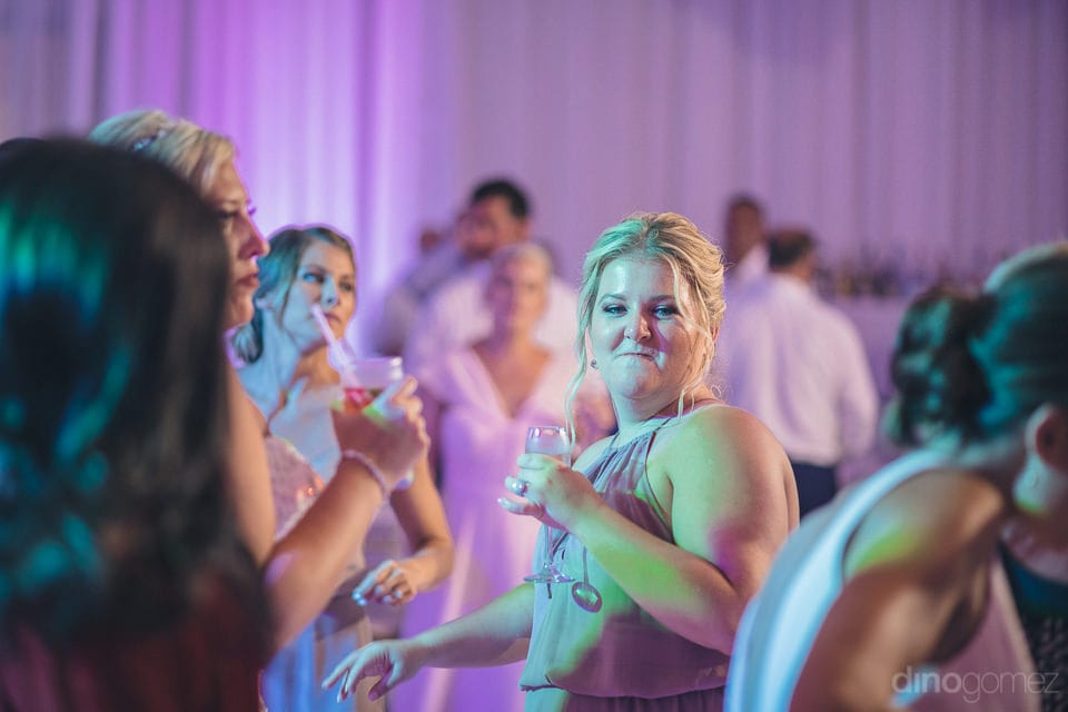 Bride and her bridesmaid are enjoying the reception dance and drinks along with other guests -Shannon & Jordan