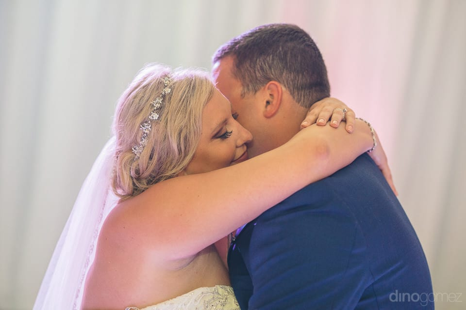 Gorgeous couple hugging loveingly each other during the reception dance in the evening - Shannon & Jordan