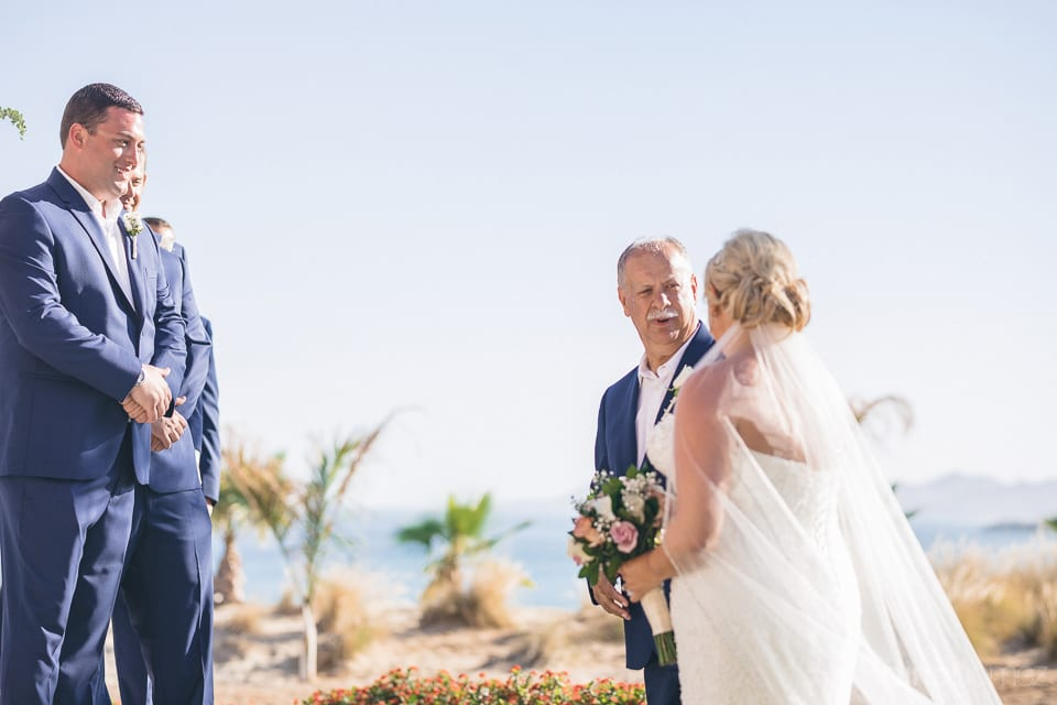 The bride is standing near her wedding stage and is talking to the gentleman just before stepping up to the groom at their wedding- Shannon & Jordan