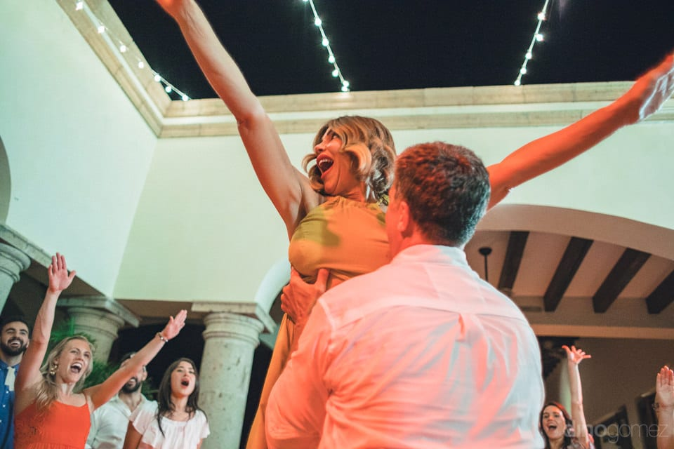 The bride can be seen in an ecstatic mood while dancing with her husband at the evening party- Dana & James