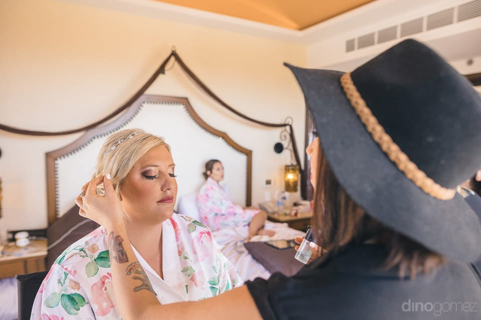 The bride is getting her final hair setting done by the makeup artist at the wedding venue- Shannon & Jordan