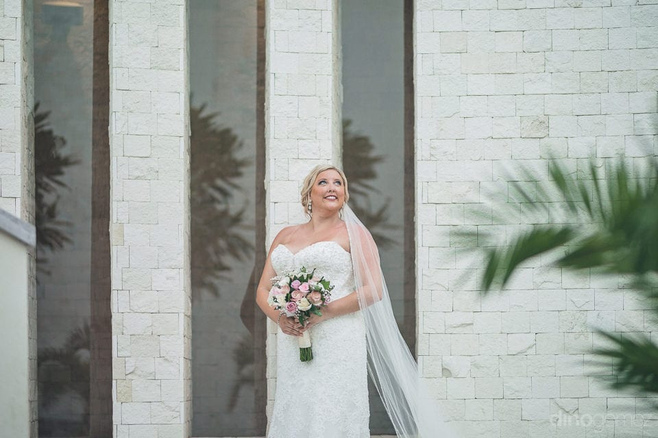Lovely bride is looking stunning while and looking at the sky to give a pose for the camera- Shannon & Jordan