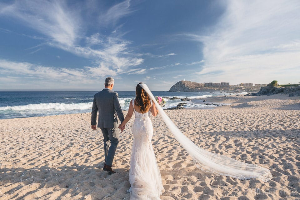 Gorgeous couple looking picture perfect while walking at the beach-side holding hands- Dana & James