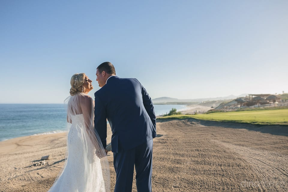 Lovely couple is holding hands while taking a walk at the sea shor inside the premises beautiful palace- Shannon & Jordan