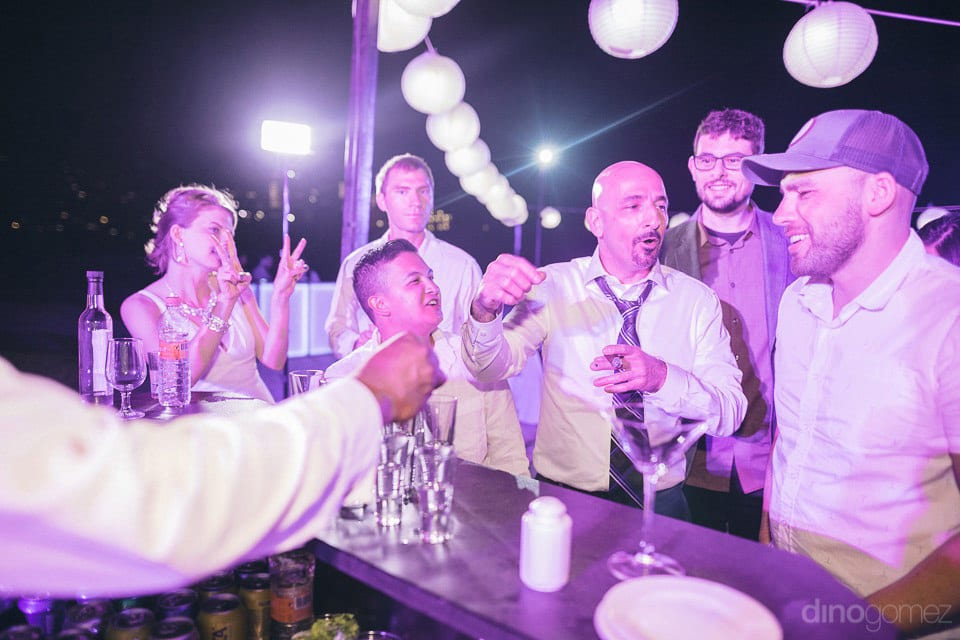 Friends celebrating the wedding of Lindsay & Clark under superb LED Lights