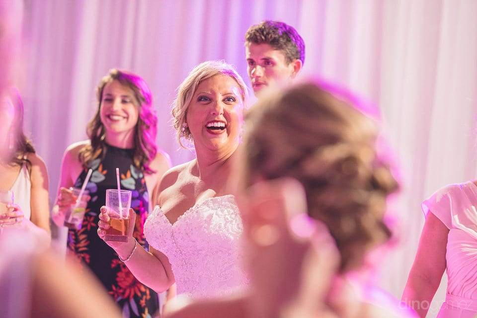 Lovely bride is laughing out loud with her friends while dancing with them during the party- Shannon & Jordan