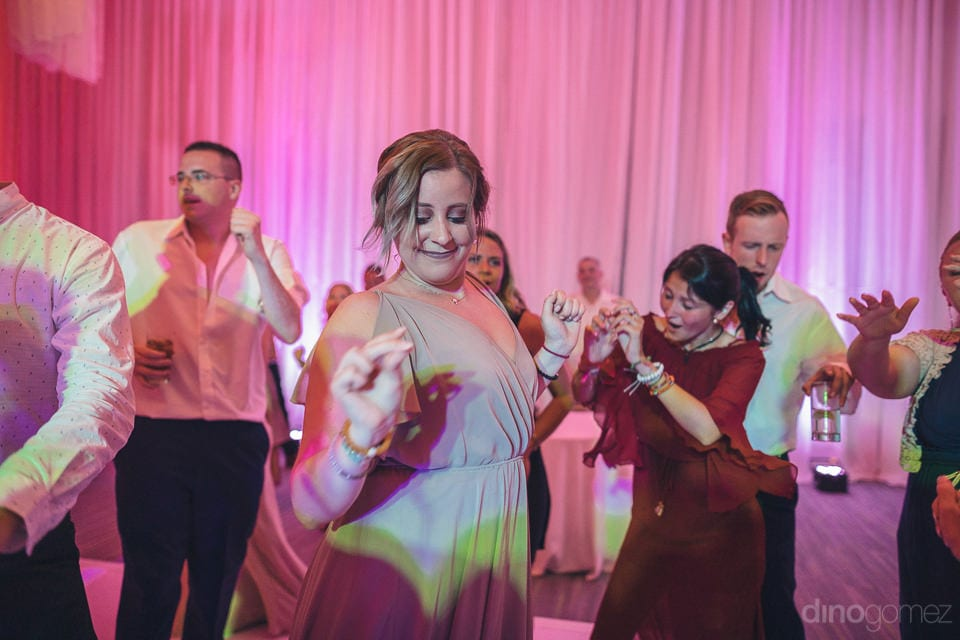A bridesmaid is dancing her heart at the evening party hosted by the beautiful couple- Shannon & Jordan
