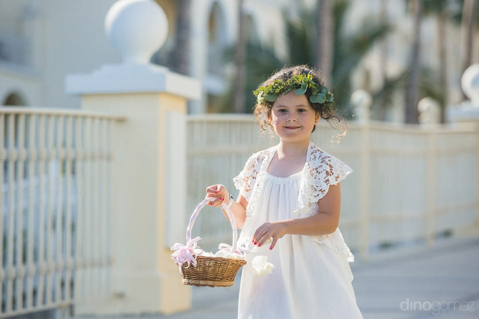 Little fairy dressed in white spreading flowers at venue for the arrival of beautiful couple- Aubrey & Chris