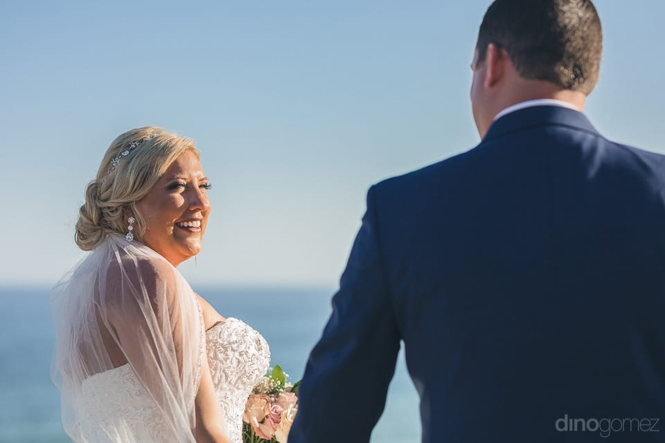 The lovely couple is smiling standing near to the sea posing for the camera- Shannon & Jordan