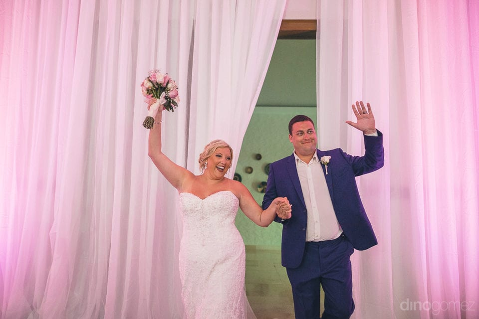 Pretty couple dancing while entering the reception ballroom for the evening dinner party- Shannon & Jordan