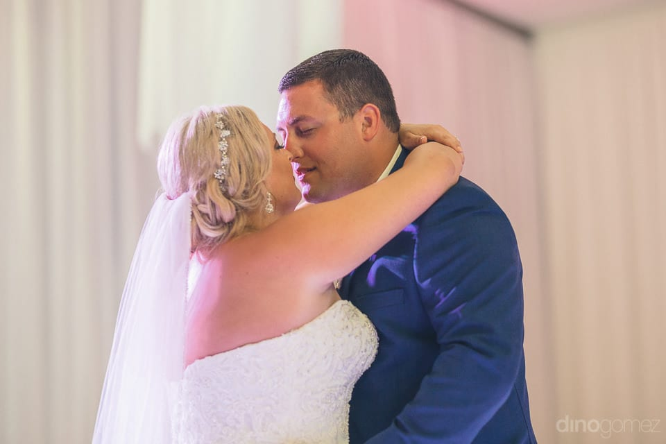 The gorgeous couple about to kiss each other while dancing at the evening party- Shannon & Jordan