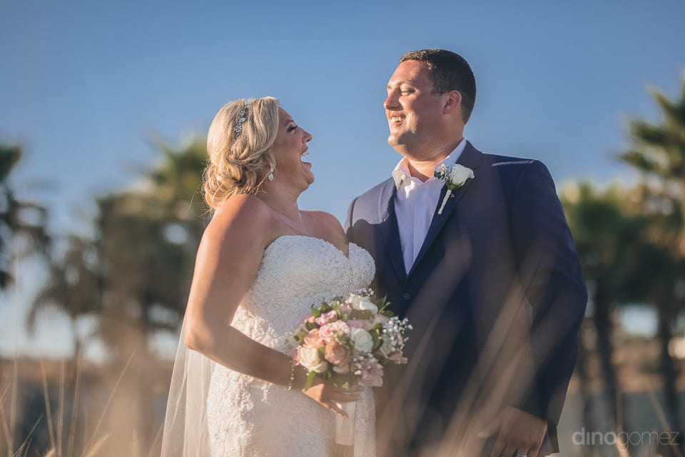 Pretty Couple Laughing Loudly At With Each Other Standing In The Beautiful Garden Of The Palace- Shannon & Jordan
