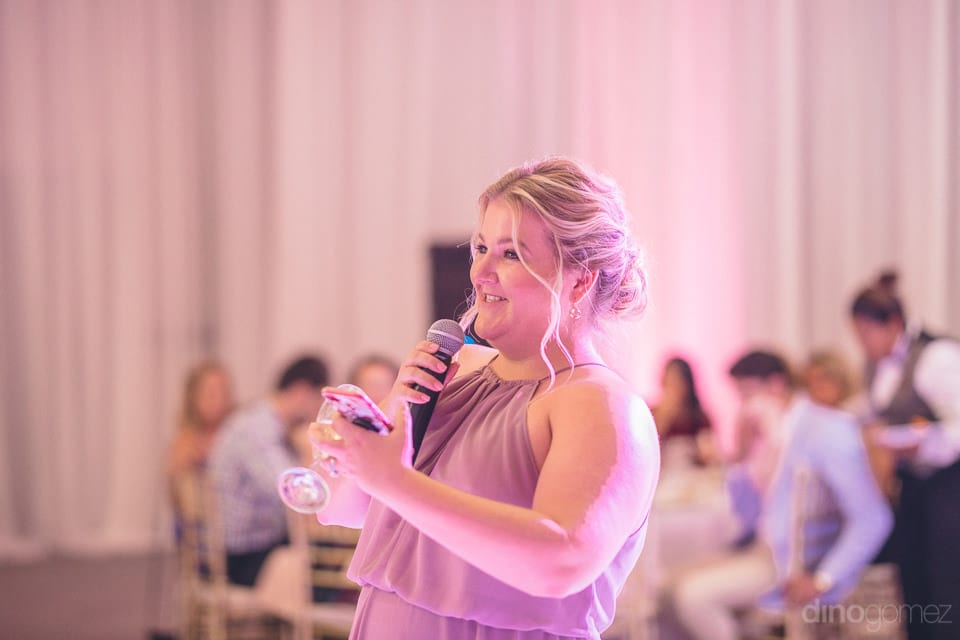 A lovely lady is holding the mike and speaking a few words of love for the couple at their evening reception party- Shannon & Jordan