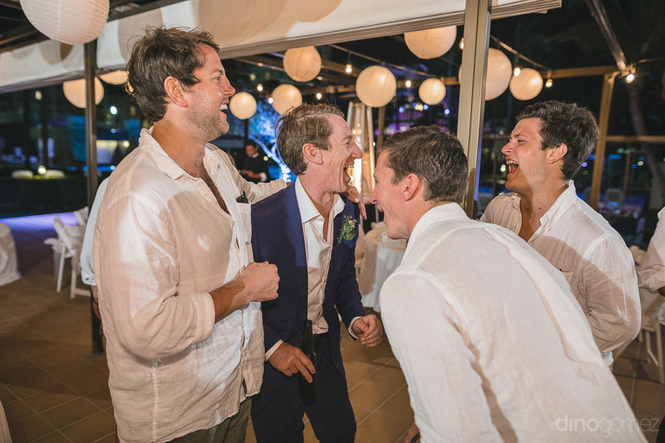 The groom can be seen laughing out loud with his friends at the evening dinner party- Aubrey & Chris