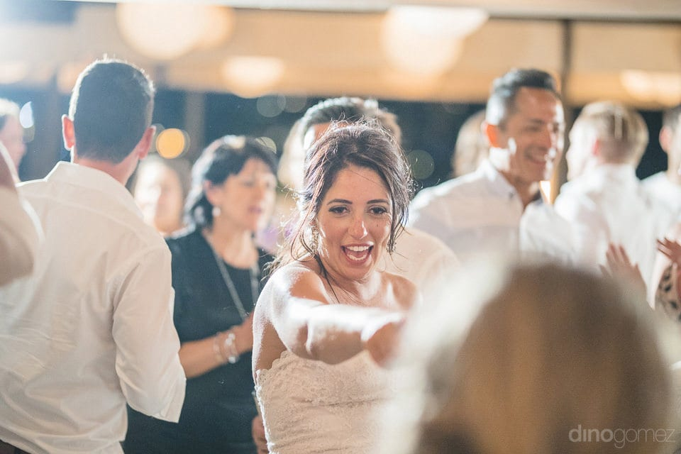 The bride can be seen dancing with her friends at the dinner party along with her groom- Aubrey & Chris