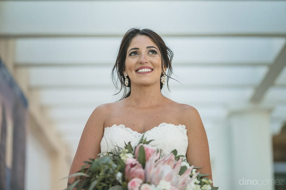 Beautiful bride in white gown holding her bouquet of white and pink flowers all ready for the wedding day- Aubrey & Chris