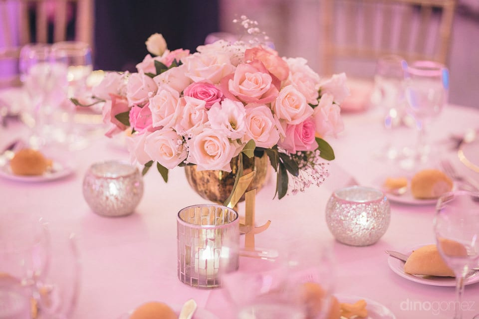 The dinning table at the reception party of the couple is looking fabulous with beautiful flowers and candles- Shannon & Jordan