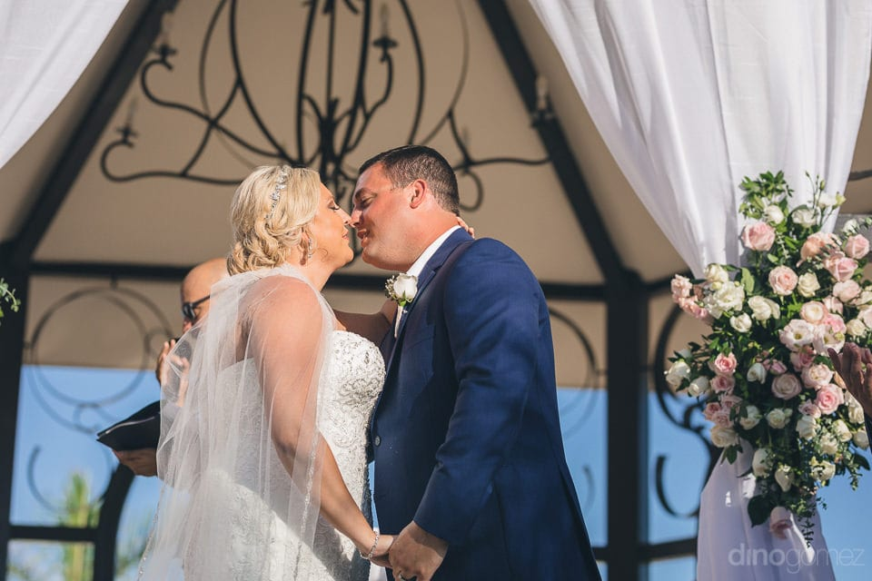 A beautiful kissing moment of the lovely couple after the completion of wedding ceremonies-  Shannon & Jordan