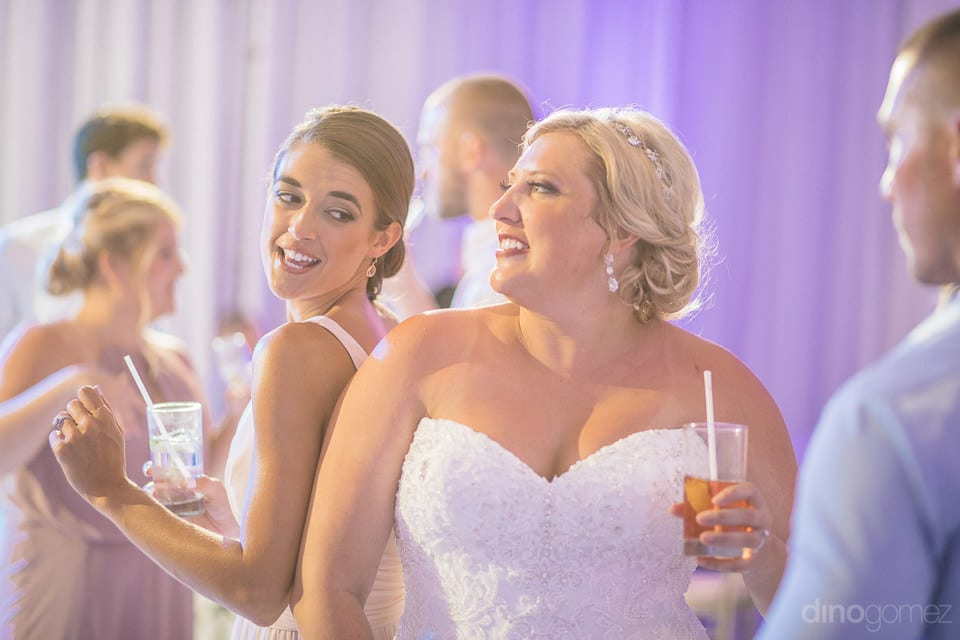 Lovely bride and a beautiful young lady are dancing at the evening party hosted by the sweet couple- Shannon & Jordan