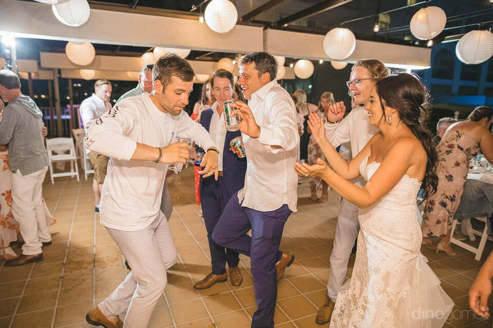 Bride and groom can be seen holding beer cans and enjoying dance with the friends- Aubrey & Chris