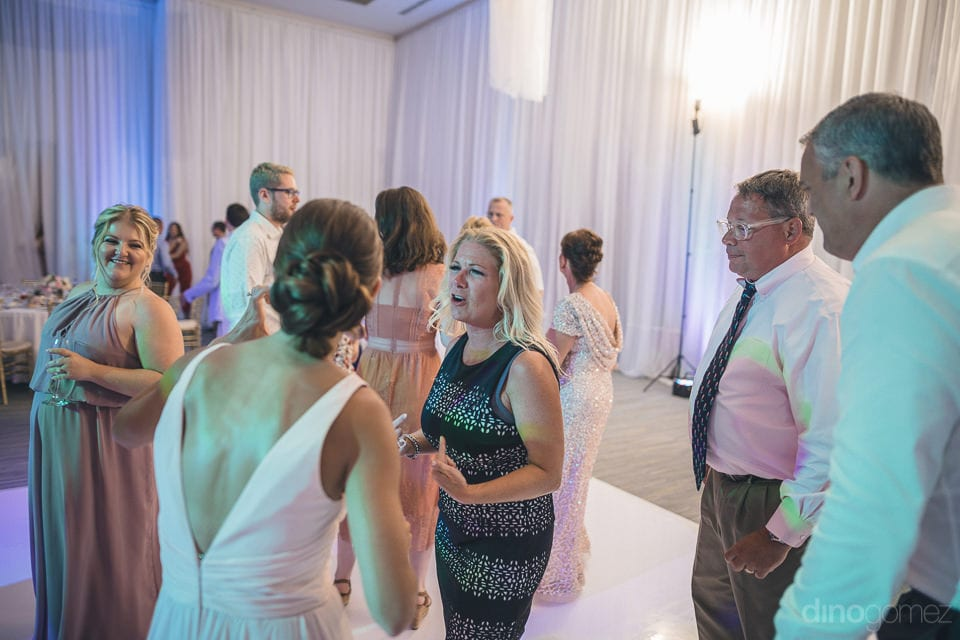 Lovely ladies and handsome men are standing on the dance floor and enjoying the dace party hosted by the couple- Shannon & Jordan