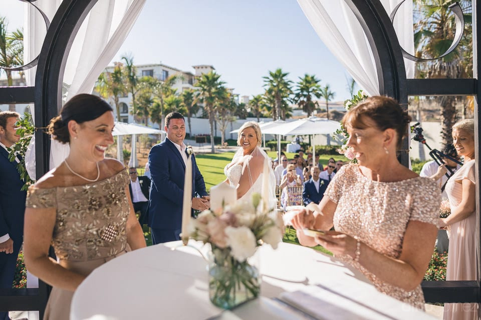 Two beautiful women near to the couple are standing along the table and posing for the camera- Shannon & Jordan