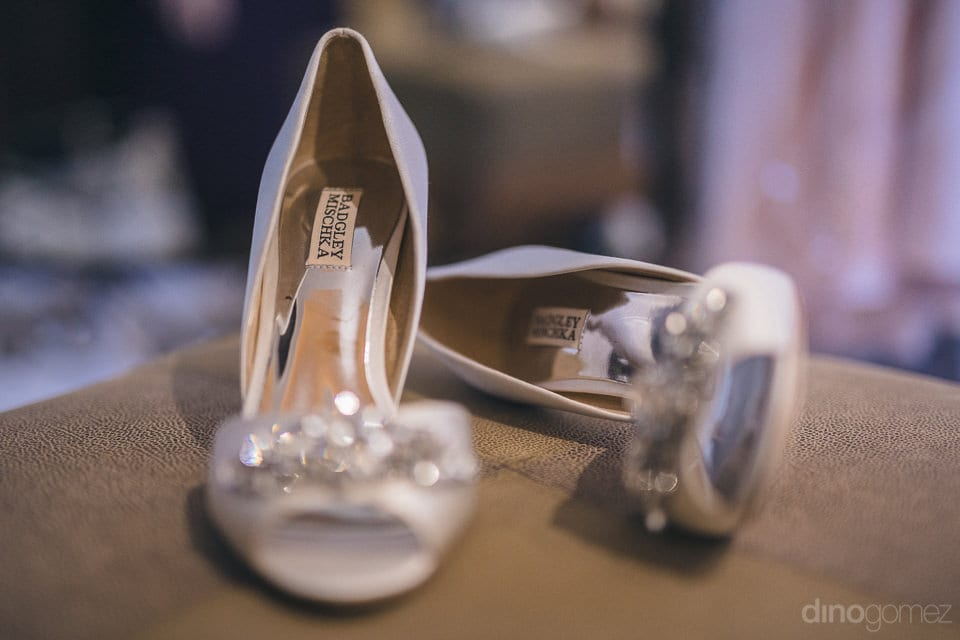 Beautiful designer silver heels of the bride are captured in the picture to be worn during the wedding- Shannon & Jordan