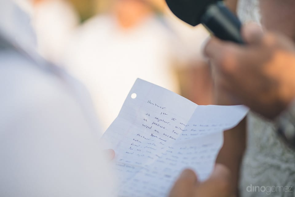 The image captures the hand-written note which is being read by the groom after taking his wedding vows- Heather & Ross