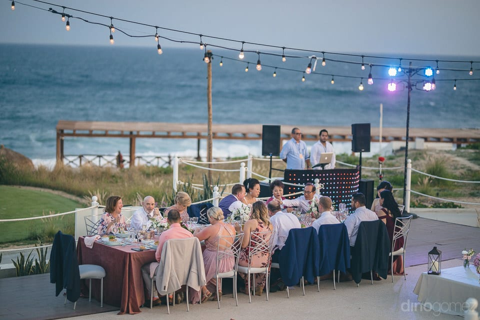 All the guests along with the couple are enjoying the reception dinner at the beach side- Jay & Drew