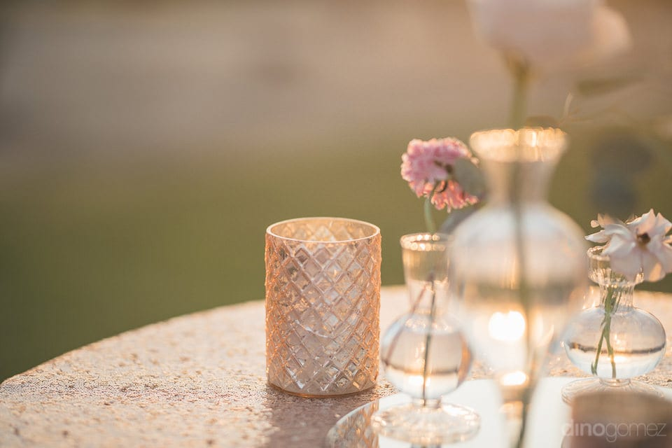 The picture focusses on the beautiful criss-crossed metallic candle holder placed on the dinning table of the couple- Jay & Drew