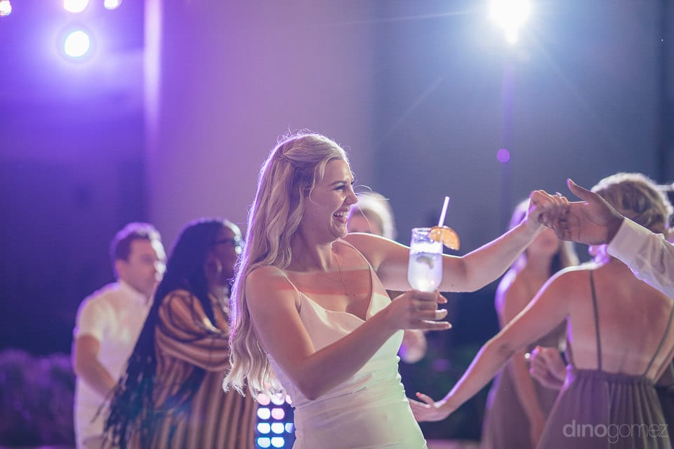 Lovely bride is smiling brighly while dancing on the dance floor during the reception party of the couple- Amber & Josh