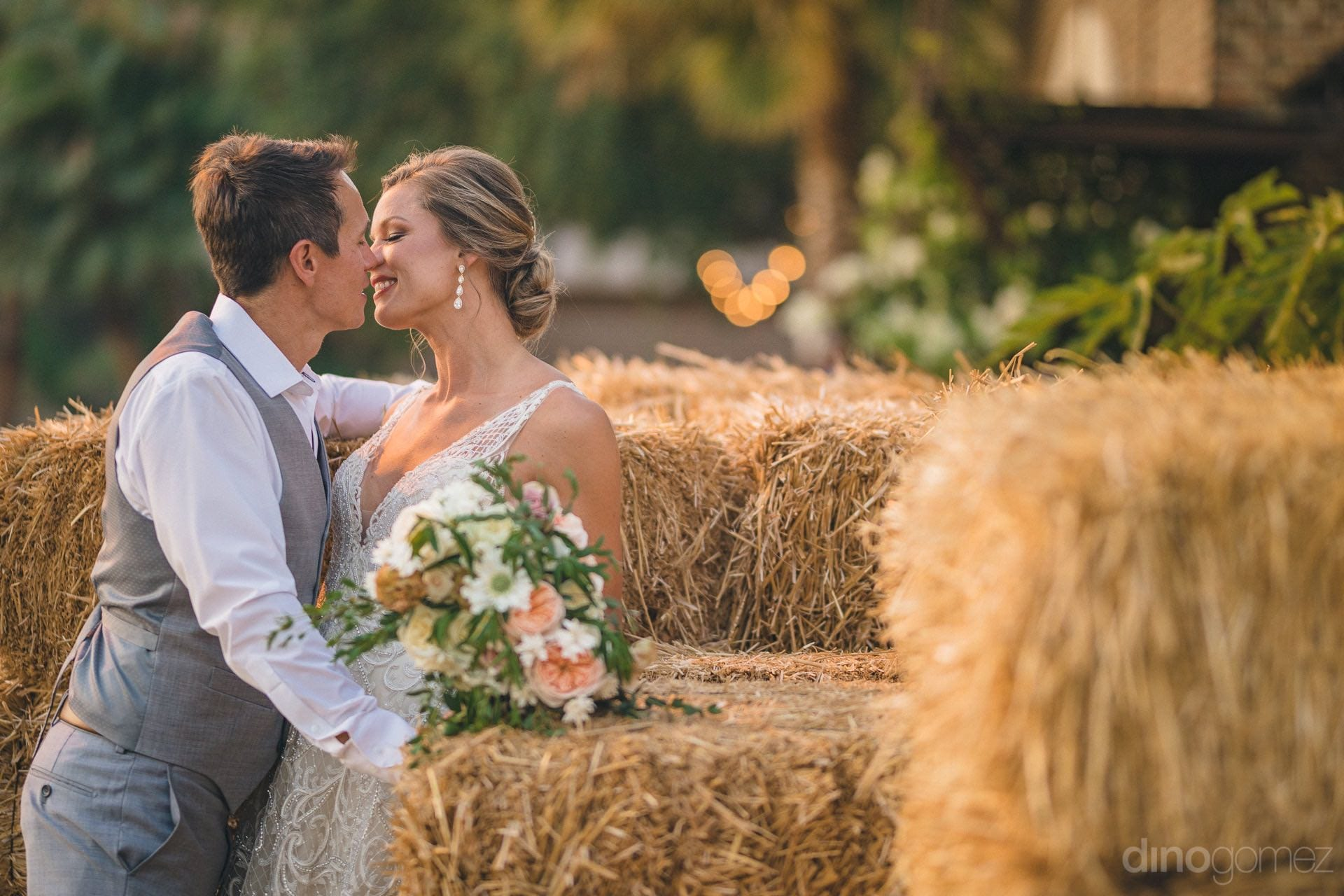 Lovely newly married husband and wife are standing taking rest on the hay bundles and are about to kiss each other- Heather & Ross