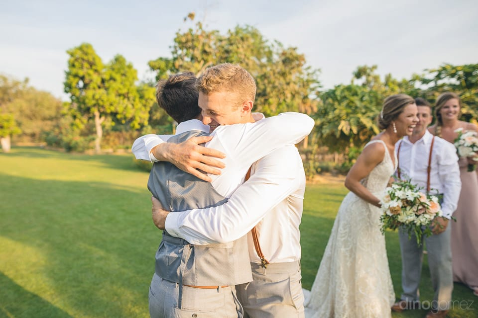 The groom can be seen giving a hug to one of the handsome man after the completion of wedding ceremonies- Heather & Ross