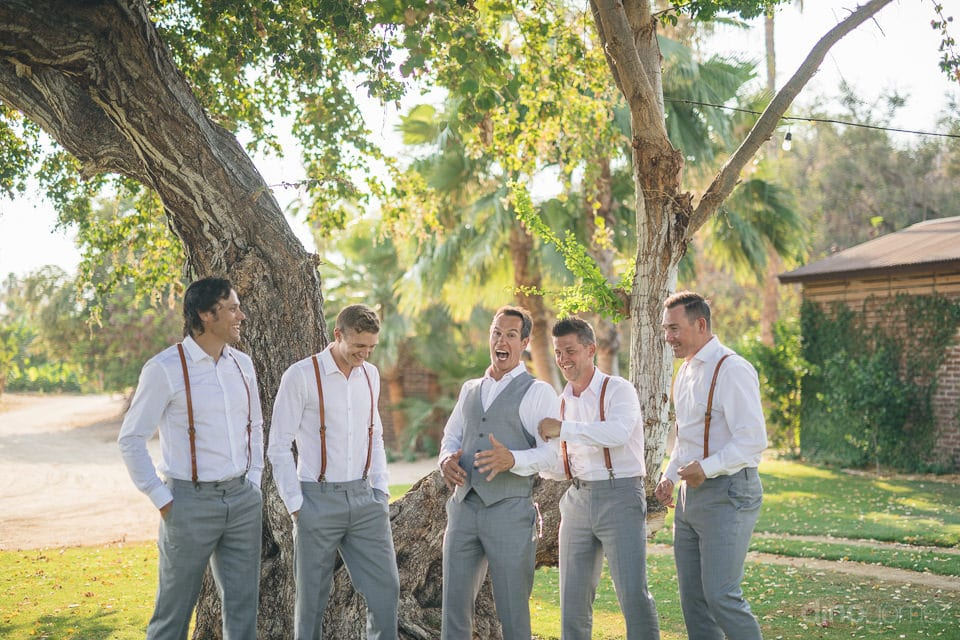 The groom along with his friends is laughing out loudly before the beginning of the wedding ceremonies- Heather & Ross
