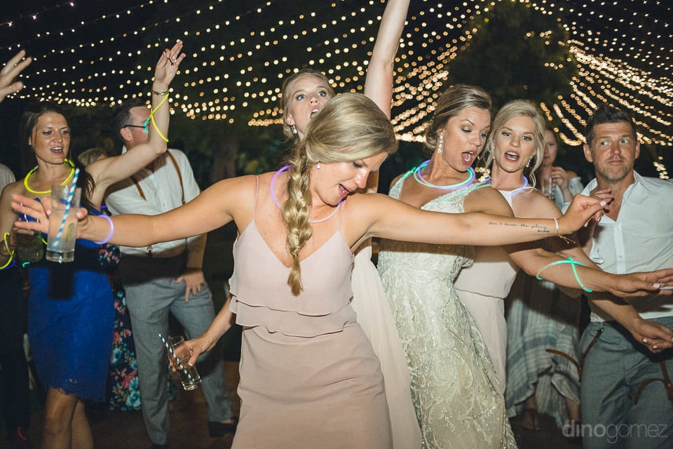 The bride and her bridesmaids can be seen performing a dance step together during the evening dance party of the couple- Heather & Ross