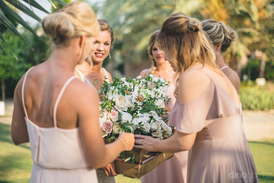 All the beautiful bridesmaids are picking their wedding bouquet to attend the wedding of lovely couple- Heather & Ross