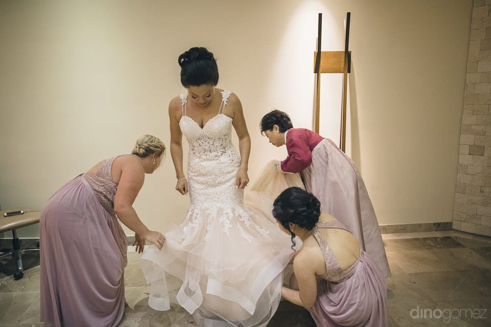 The bride is dressed in beautiful white gown which is set by lovely ladies- Jay & Drew