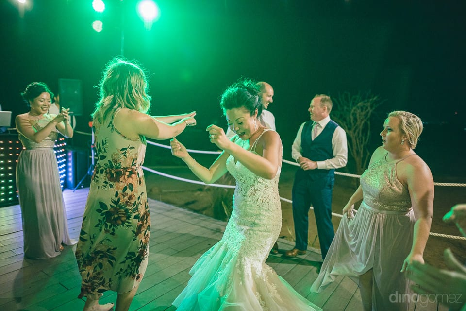 Lovely bride is dancing with all the girls at her reception party- Jay & Drew