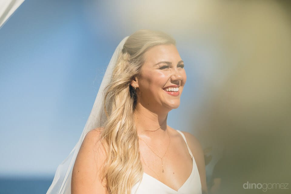 The picture focuses on the smiling face of the lovely bride- Amber & Josh
