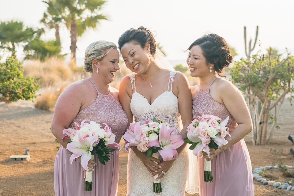 Lovely bride is smiling with her bridesmaid under the beaitiful sky- Jay & Drew