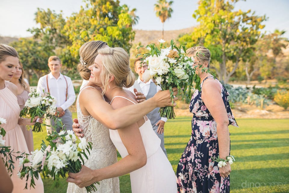 Lovely bride is hugging one of the bridesmaids after the wedding ceremonies- Heather & Ross