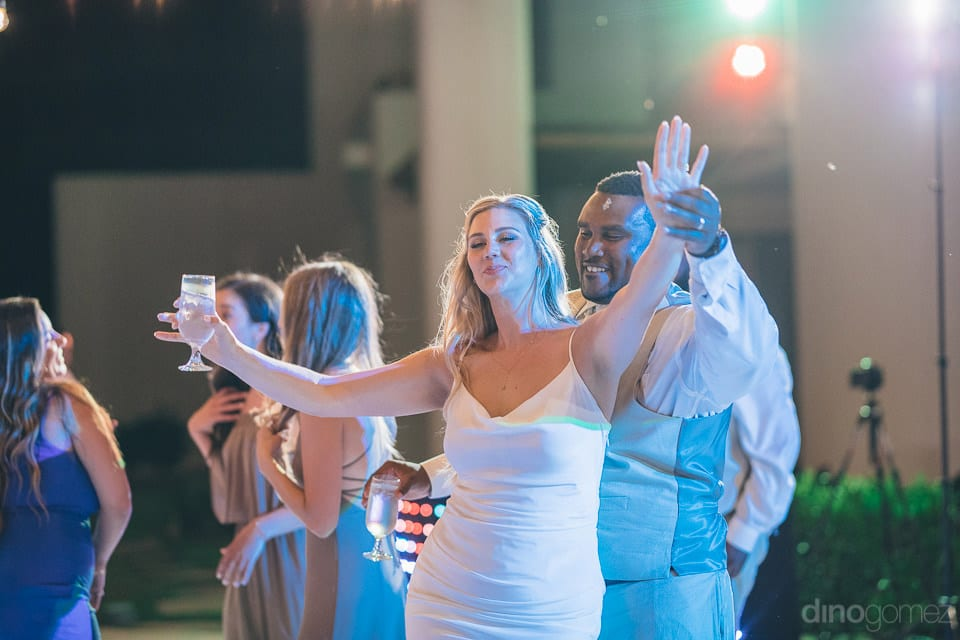 Lovely bride is enjoying the evening dance party to the fullest with her husband- Amber & Josh