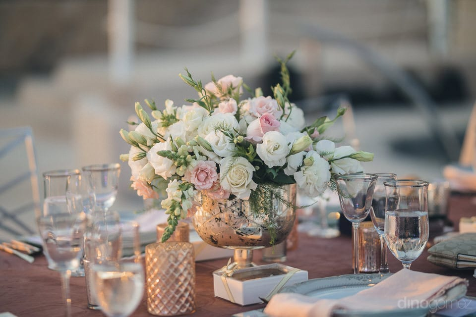 A beautiful vase with colorful flowers is enhancing the overall look of the dinning table at the evening party of the coupel- Jay & Drew